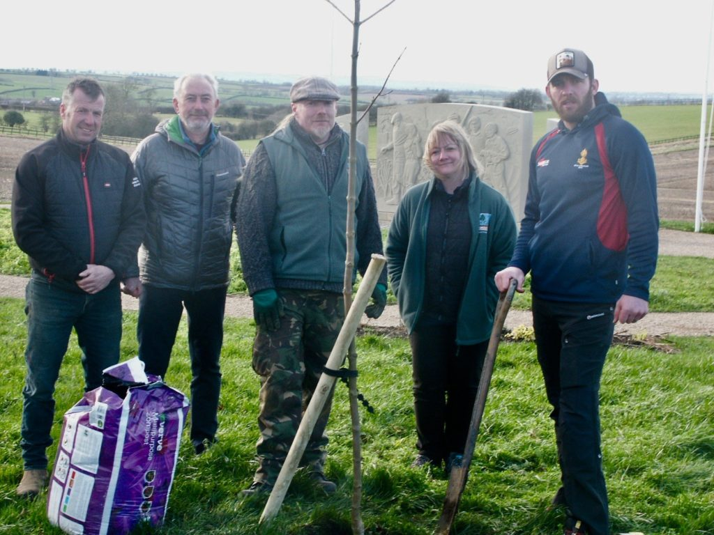 Left to right David Greaves from David Greaves Landscaping, Alec Wilson Chairman of Friends of The Tenth, Andy Wright of HighGround, Jane Taylor of HighGround and a patient from DMRC Stanford Hall